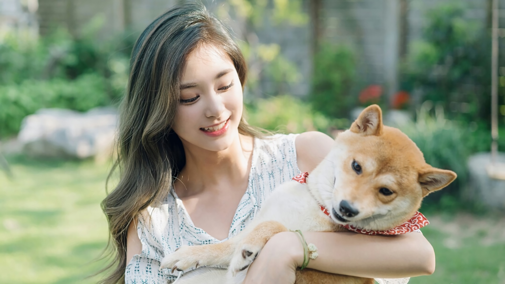 beautiful girl with dog in hands