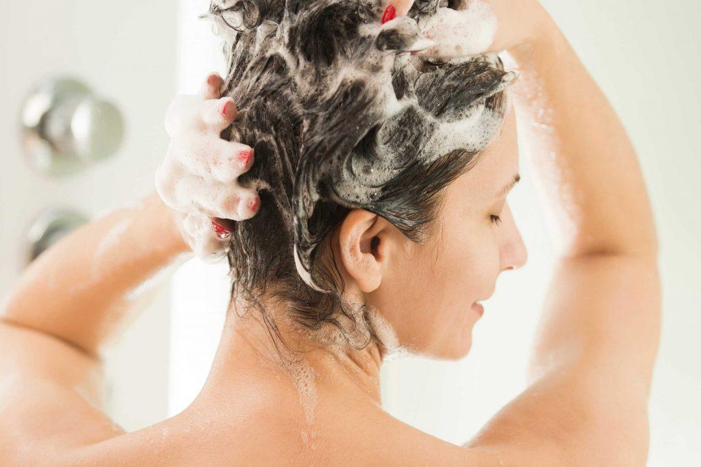girl using color protective shampoo