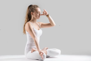 a young girl doing pranayama