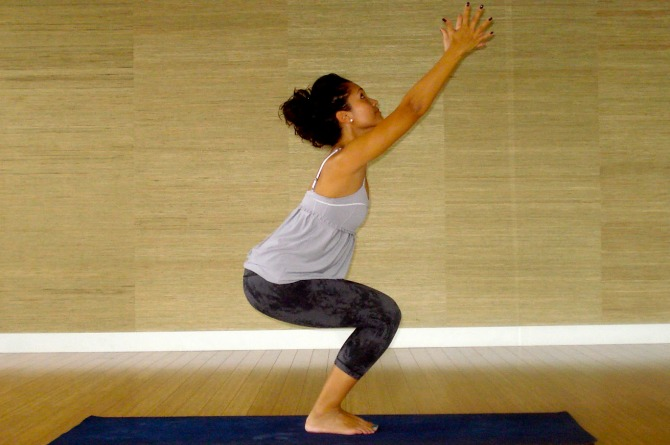 Utkatasana Chair Pose by a pregnant lady for normal delivery