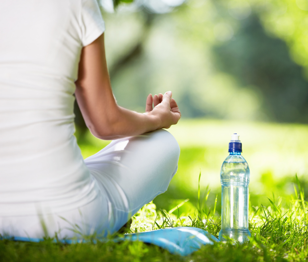 health lifestyle in corona -Woman in lotus position close-up